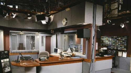 Which sitcom features this memorable radio studio?