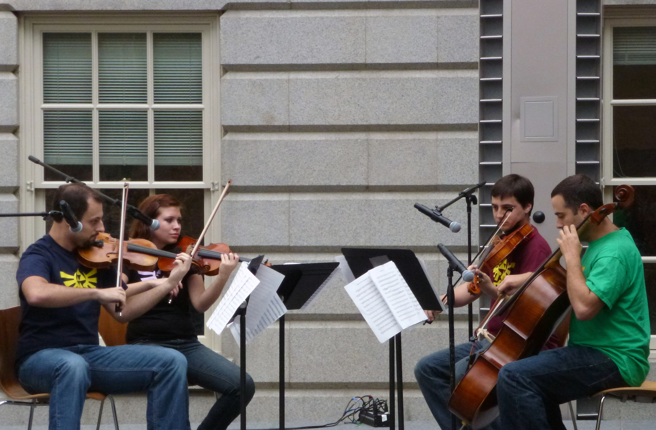 The Triforce Quartet plays in the courtyard during the exhibit's opening weekend. They performed theme songs to a variety of games throughout the day.