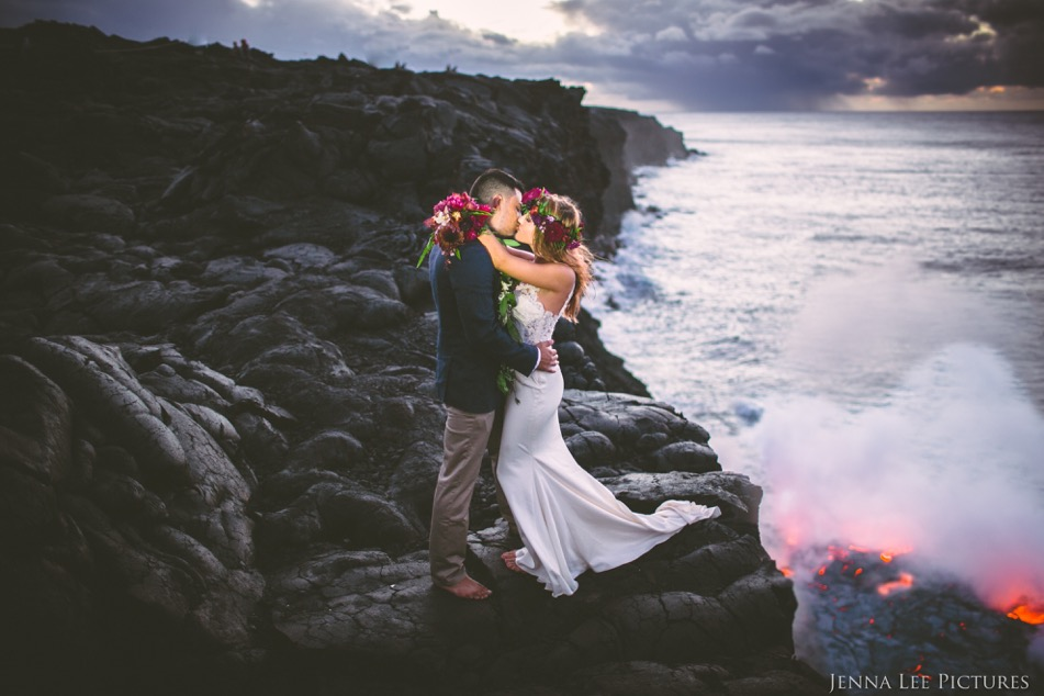 Alex and Lauren Michaels kiss as lava from Kilauea flows into the Pacific Ocean on August 11. This was the first time the lava reached the ocean since 2013.