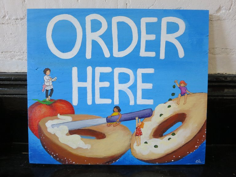 Signs for Tompkins Square Bagels in NYC