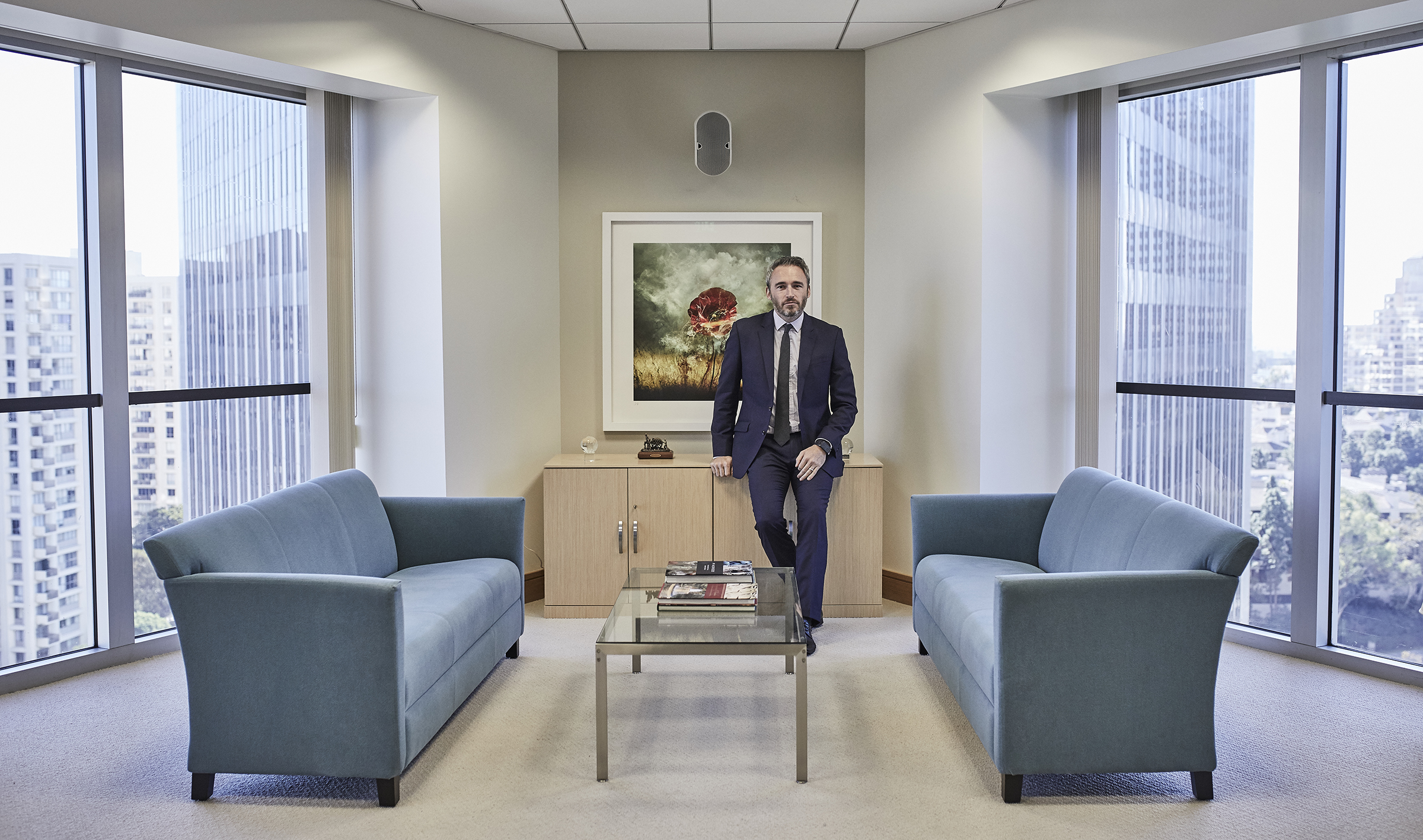 """British Consul General Mike Howells in his office with """"War Poppy 1""""  Portrait by Jacob Rushing"""
