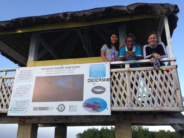 Heather, Marisa, and village official in damaged MPA guardhouse.  Photo: ZSL