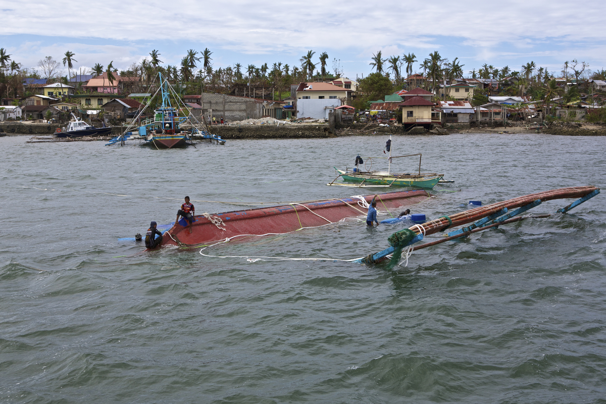 Typhoon Yolanda affected many fishermen in the Visayas. On the way from Hagnaya to Bantayan there where a lot of damaged and some sunken boats.  Photo by Steve de Neef