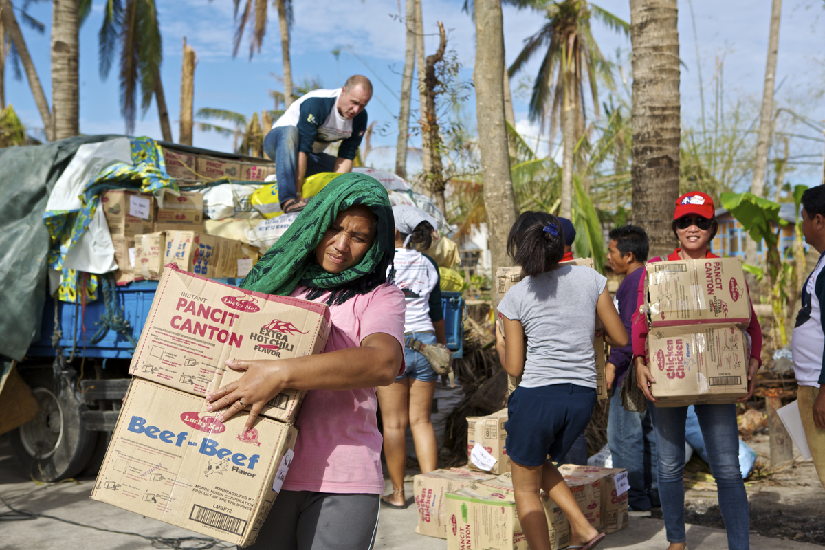 Relief goods being offloaded and distributed in Dunganon Bank, Bantayan Island to victims of Typhoon Yolanda.  Photo by Steve de Neef