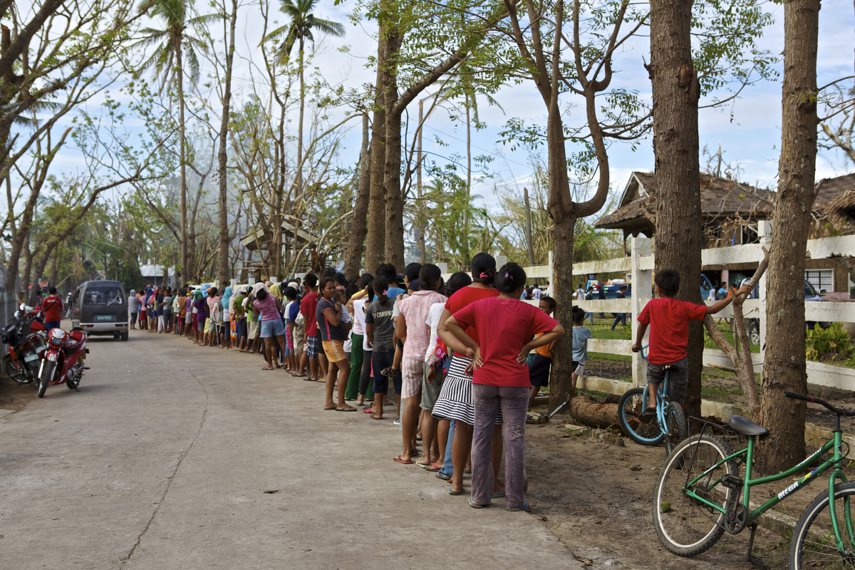 People waiting in line in Dunganon Bank, Bantayan to receive relief goods. This can take hours.  Photo by Steve de Neef