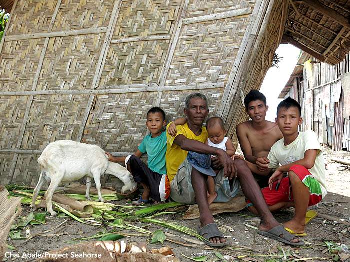 A father and his four sons sit outside their storm-damaged house. Bantayan Town. Photo: Chai Apale/Project Seahorse