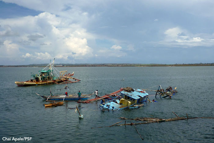 Fishing boats destroyed during the storm near Bantayan, Philippines.  Photo: Chai Apale/PSF