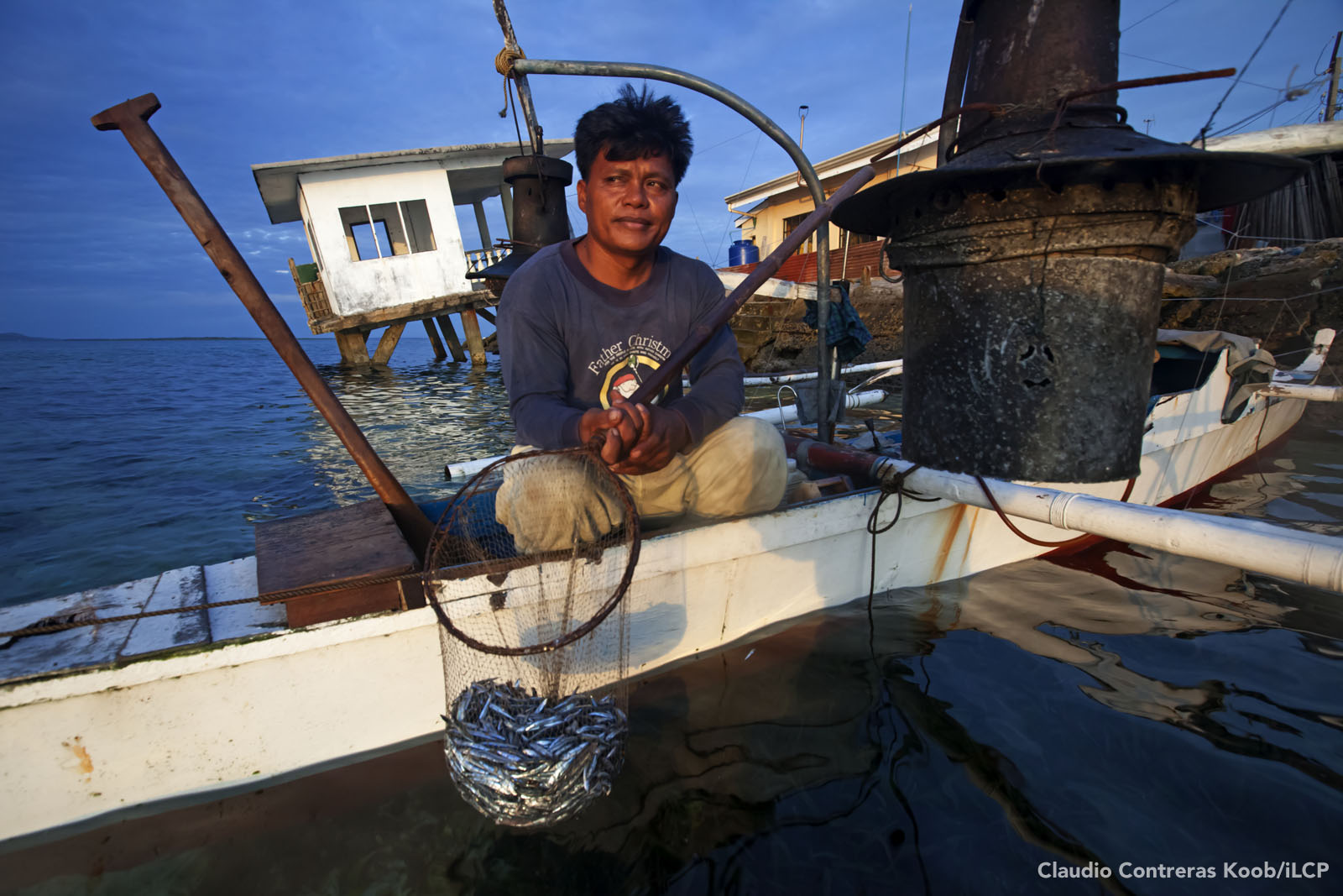 A fisher with his catch. A night's work might yield two kg of fish, worth about US $2.50. A generation ago, fishers fed entire families on just a few hours of fishing. Claudio Contreras Koob/iLCP