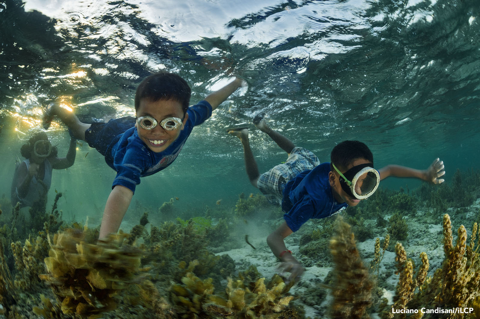 As night draws near, village kids swim out to the reef. Unless we can protect Danajon Bank, younger generations will face a difficult future. Luciano Candisani/iLCP