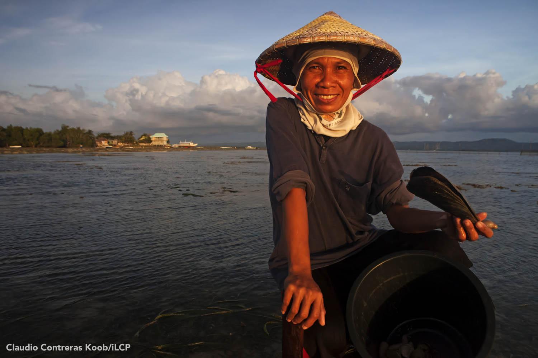 A resident of Batasan Island, Danajon Bank takes a break from collecting shells. Claudio Contreras Koob/iLCP
