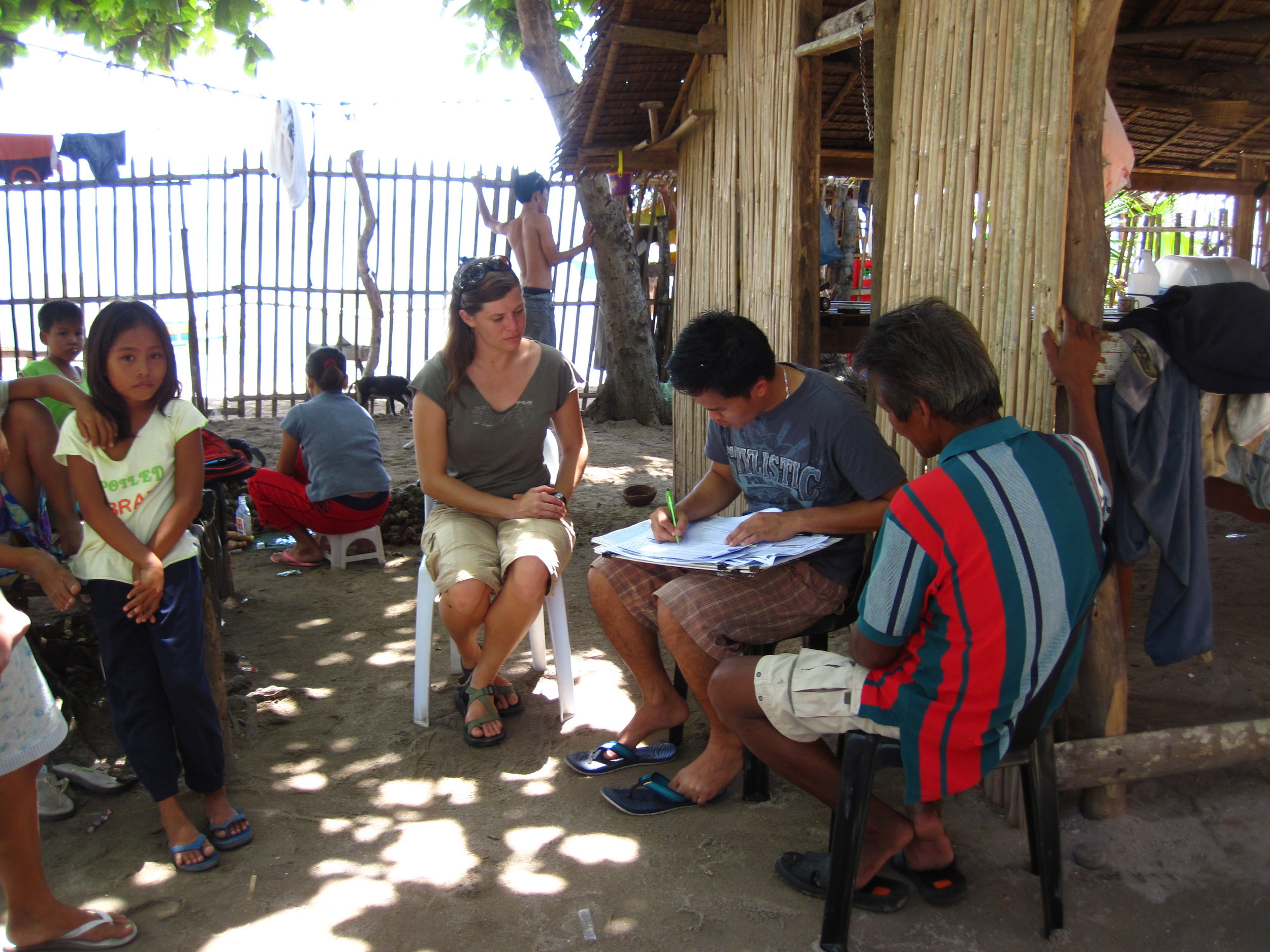Jenny and a local research assistant interviewing a fisher about the long-term changes in his fishing practice.