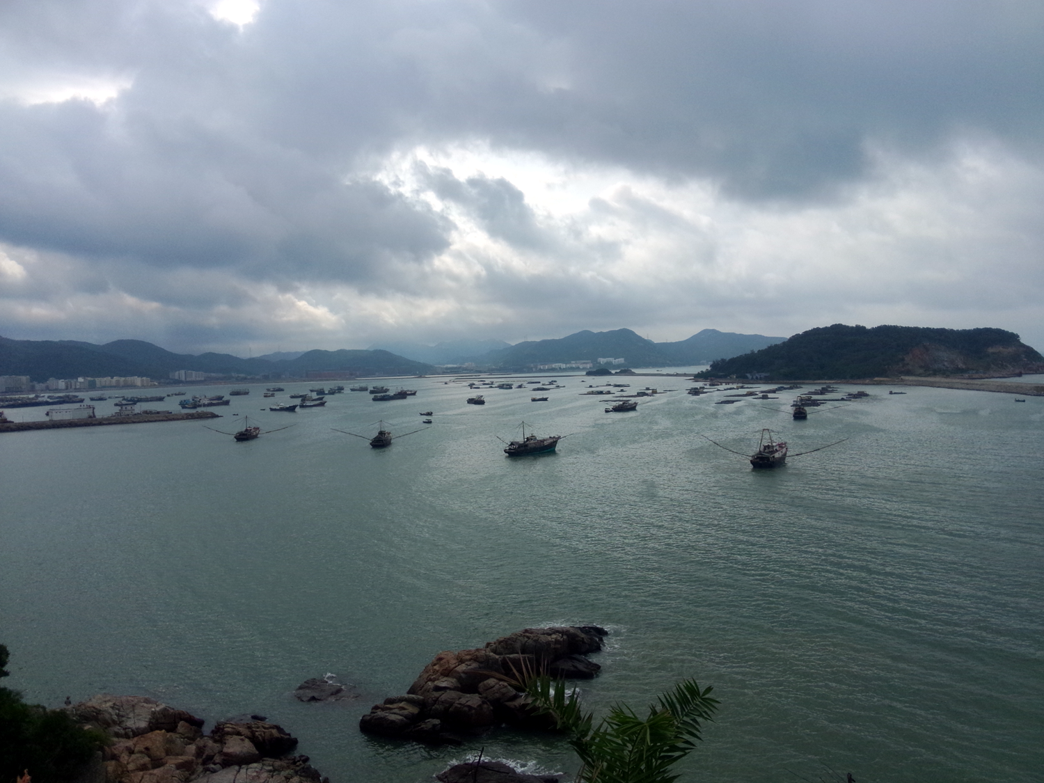 China has massive fishing ports along its long coastal bays. Here is a photo of a bay in Guangdong (Canton) where a fishing port is located. In April throughout October 2015, I visited more than 50 fishing ports to interview fishers.