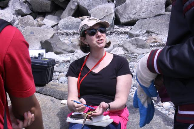 Dr Sigal Balshine teaching on the beach