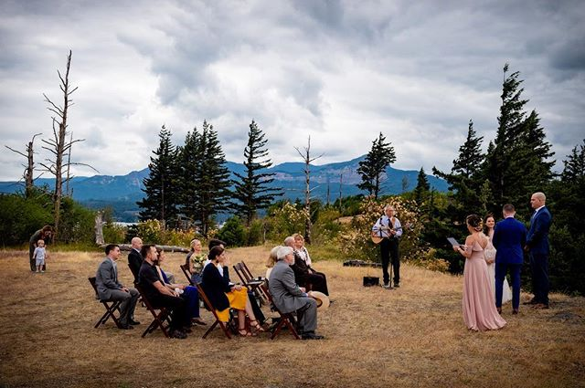 When you invite the perfect gang of your favorite people, get married in a field with a river view, hire a musician to play along with the sound of water and wind, and refuse to worry about the things that don't matter to you, magic happens.  Thank heavens for elopements, where we get to tell our own story and plan a celebration that speaks to our souls. #elopement #elopementwedding #elopeinoregon #elopeadventurously #tinywedding #columbiarivergorgeelopement #columbiarivergorgewedding #adventurewedding #aralaniphotography