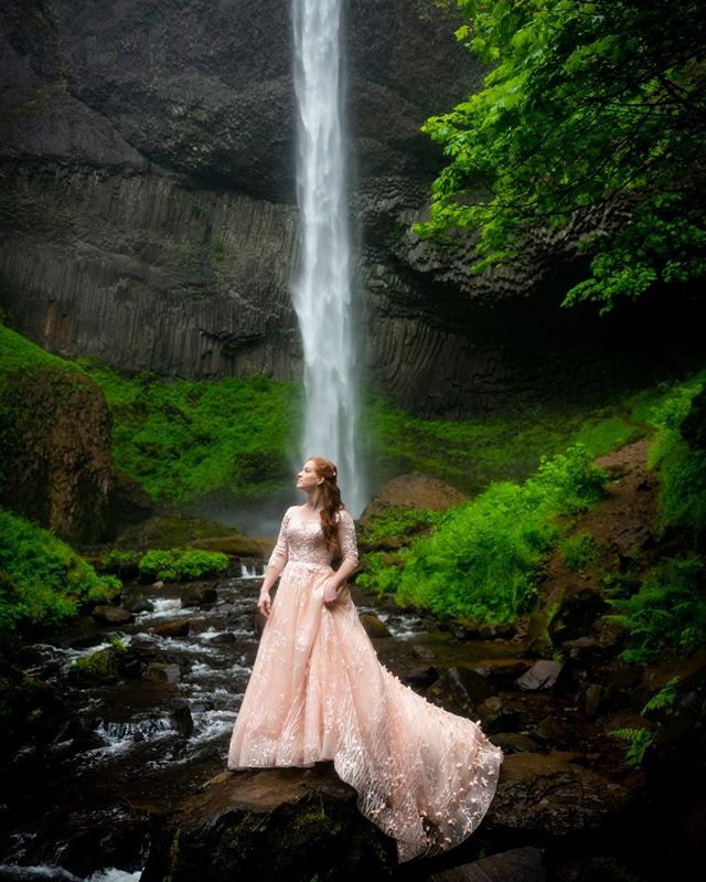 A knockout redheaded fairy princess wearing a rose gold wedding dress in the mossy forest?  Oh, yes please. #elopeinoregon #waterfallwedding #rosegoldwedding #rosegoldweddingdress #redheadbride #oregonwaterfallwedding #landscapewedding #aralaniphotography