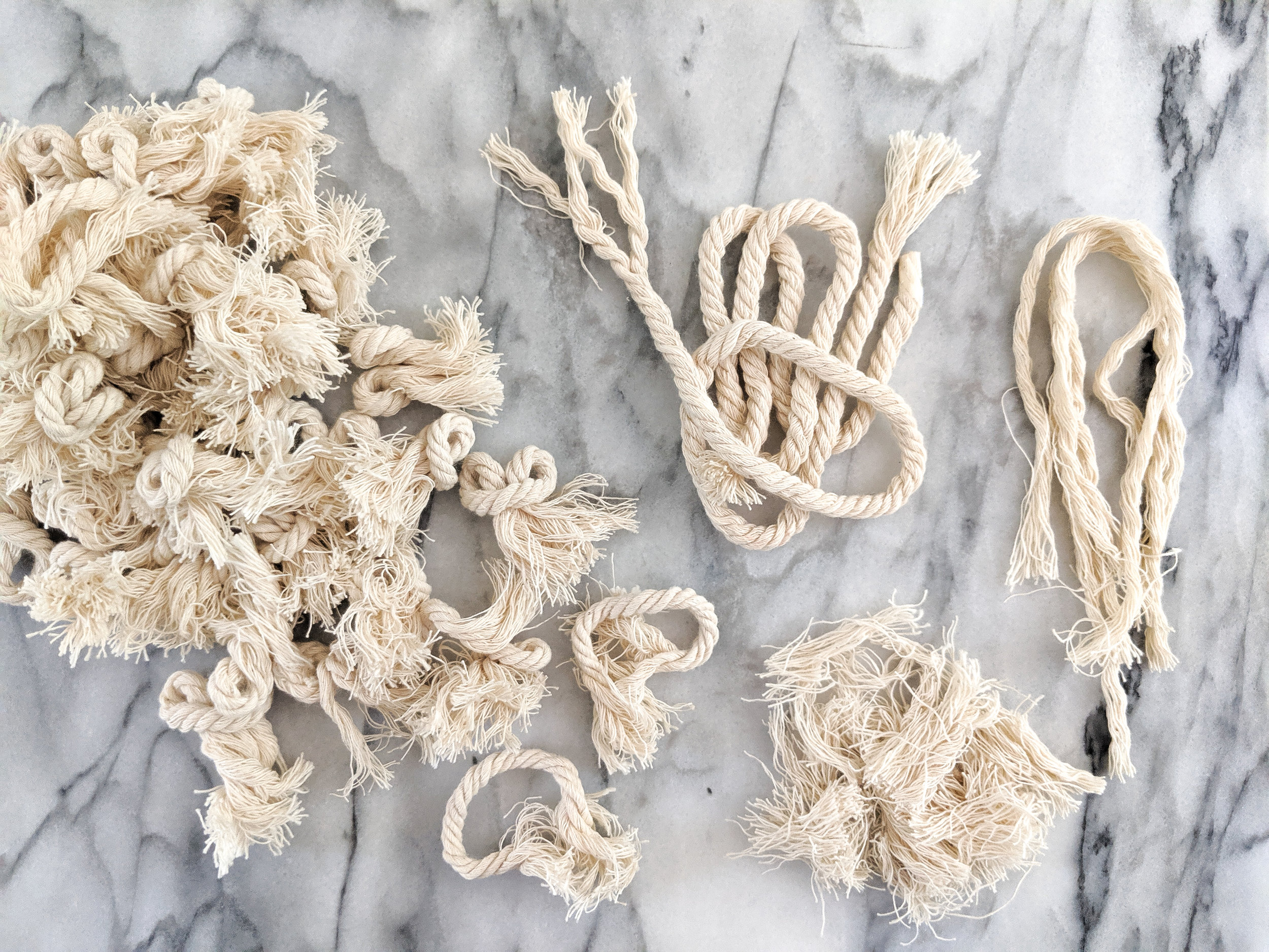 This is all from the same rope source. This can be unwound and made into softer groups of cotton. The small shredded bits are leftover trim from my tassels that can be used as stuffing!