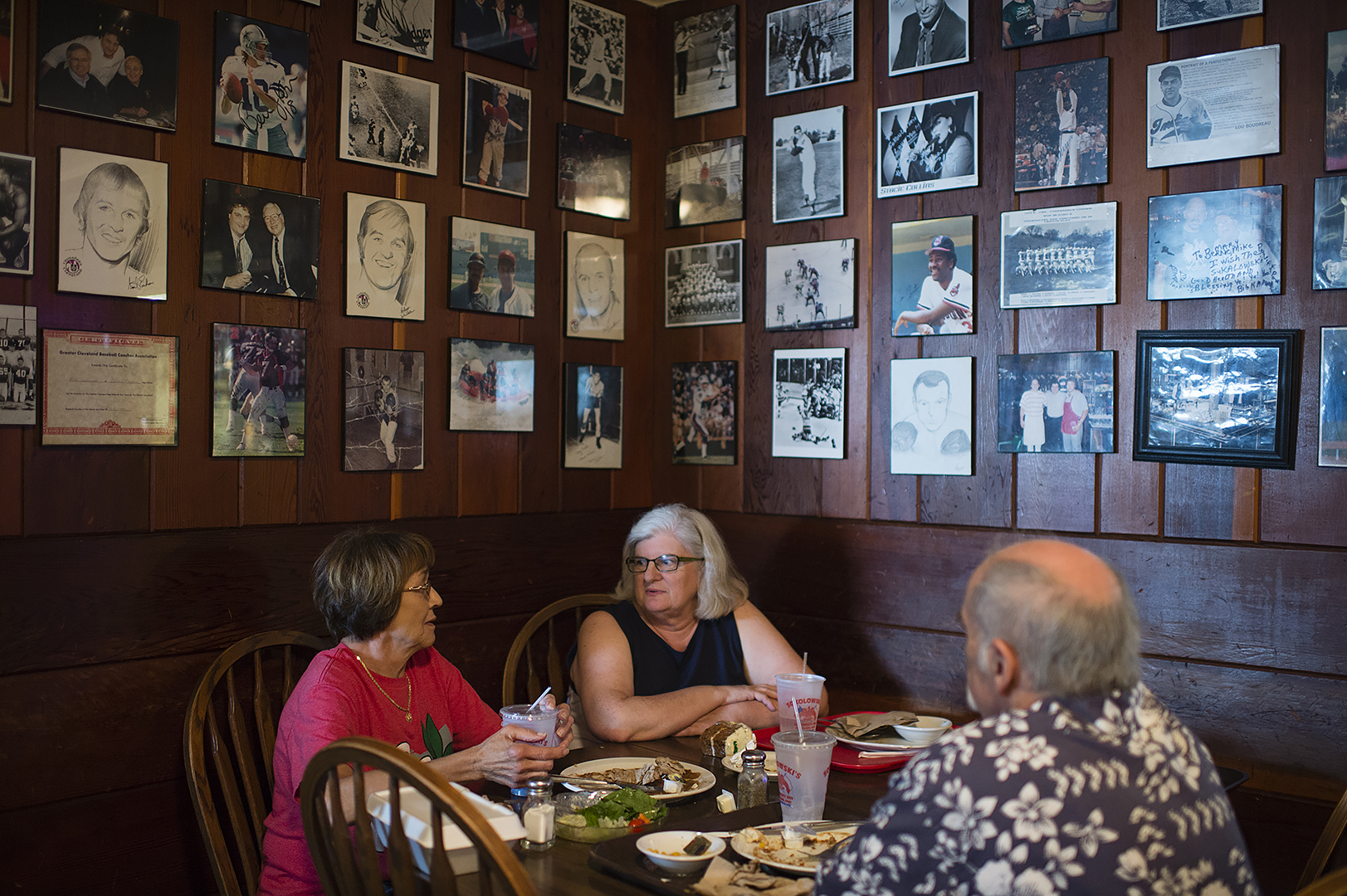 Patron's can enjoy a homey atmosphere in one of the three dining rooms at Sokolowski's University Inn, each filled with historic photos of Cleveland sports, local history and plenty of images of The Pope. (Dustin Franz/The Washington Post)