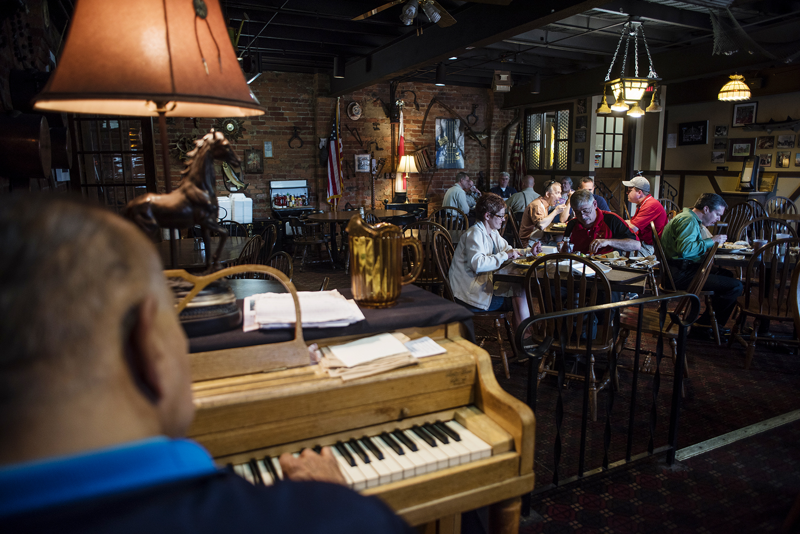 Seventy-one-year-old pianist Tom Ballog plays to lunch guests at Sokolowskis University Inn in Cleveland's Tremont neighborhood on July 1, 2016. Ballog has played all over the country thoughout his life and has 1500 songs commited to memory. (Dustin Franz/The Washington Post)