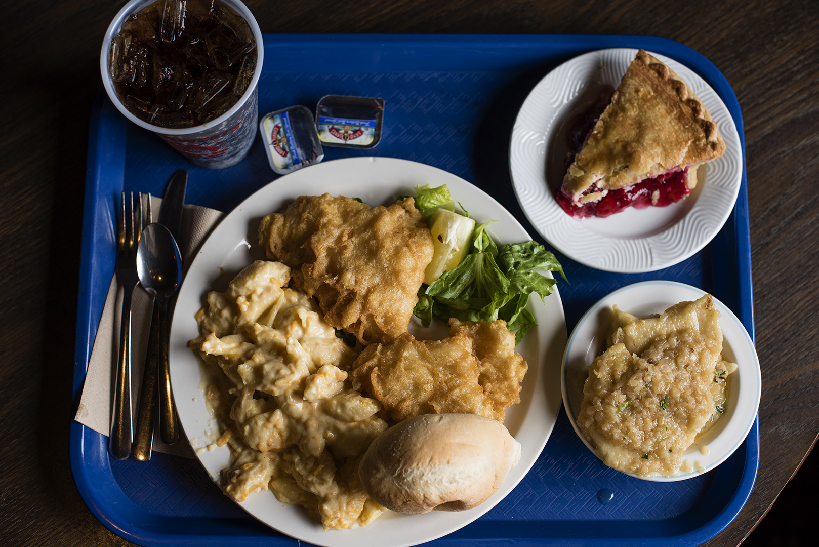 Fresh fried cod served with macoroni and cheese, a dinner roll, pierogies and a slice of cherry pie for dessert. (Dustin Franz/The Washington Post)