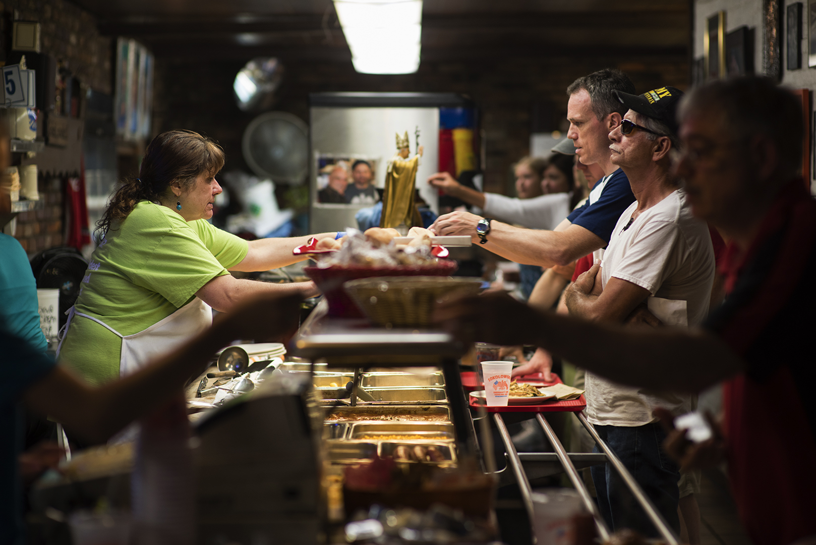 Patrons go through the cafeteria syle line during the lunch rush at Sokolowski's University Inn on July 1 in Cleveland's Tremont neighborhood. (Dustin Franz/The Washington Post)