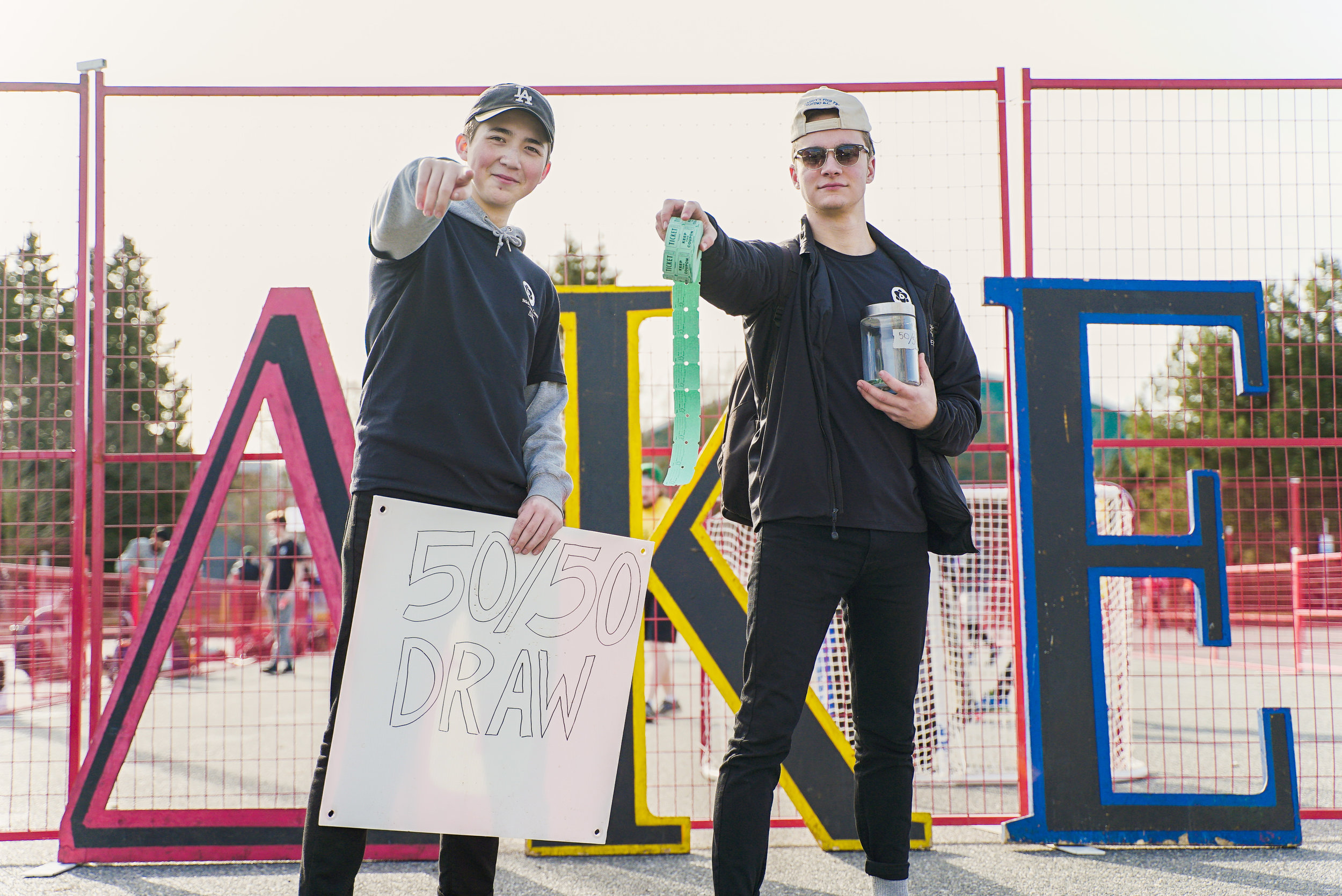Brothers Sam Maunsell (PA '18) and Matty Klassen (PA '18) selling 50/50 raffle tickets at the Scott Trapp Stick-It to Cancer Memorial Ball Hockey Tournament; ∆KE's signature annual philanthropy event.