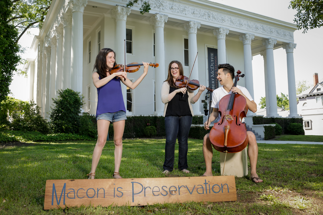 Students from the McDuffie Center for the Strings play a tune in front of the newly renovated Beall House.