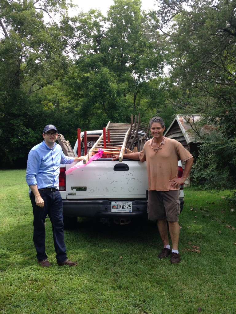 Ethiel, HMF director, and Jim pose with the Historic Macon truck after a few hours of treasure hunting.