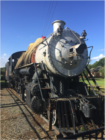In honor of my Railroad Depot research, here's the engine at the entrance to Central City Park.
