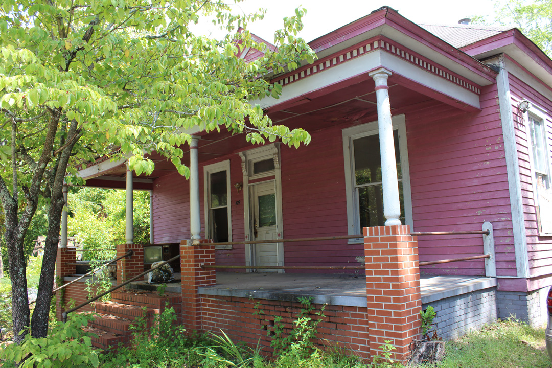 The John B. Brooks House sits on land originally known as the J.P. Lamar Sr. property in the Vineville Historic District. Built in 1908, it is indicative of the type of houses built in Vineville during the early twentieth century.  The Brooks family enjoyed the beautiful features of this house from 1908 until 1953. During that time, the family received quite a bit of attention in the  Macon Telegraph . Shortly after building this house, John Brooks appeared in court as a defendant for distilling whiskey. The City of Macon and Bibb County began establishing prohibition laws before the Prohibition Act of 1921, and James Brooks was in violation of those laws as early as 1916. Not all the coverage the family received was negative, however. John Brooks' daughter, Eva Mae Brooks, was nominated as one of the most popular young ladies in town during a vote held in the  Macon Telegraph  in 1933. John Brooks' son, James, fought during World War II, rising to the rank of corporal in the 770th Field Artillery Battalion. After the Brooks, various owners and tenants resided in the house over the years. In 2007, Lamar Street Limited, LLC acquired the property along with many others along Lamar Street.  The John B. Brooks House is in danger of DEMOLITION BY NEGLECT. As a contributing structure in the Vineville National Register Historic District, it is eligible for preservation incentives and is calling out for a new family to move in and make it home.  The solution for the John B. Brooks House is rehabilitation by a sensitive new owner.