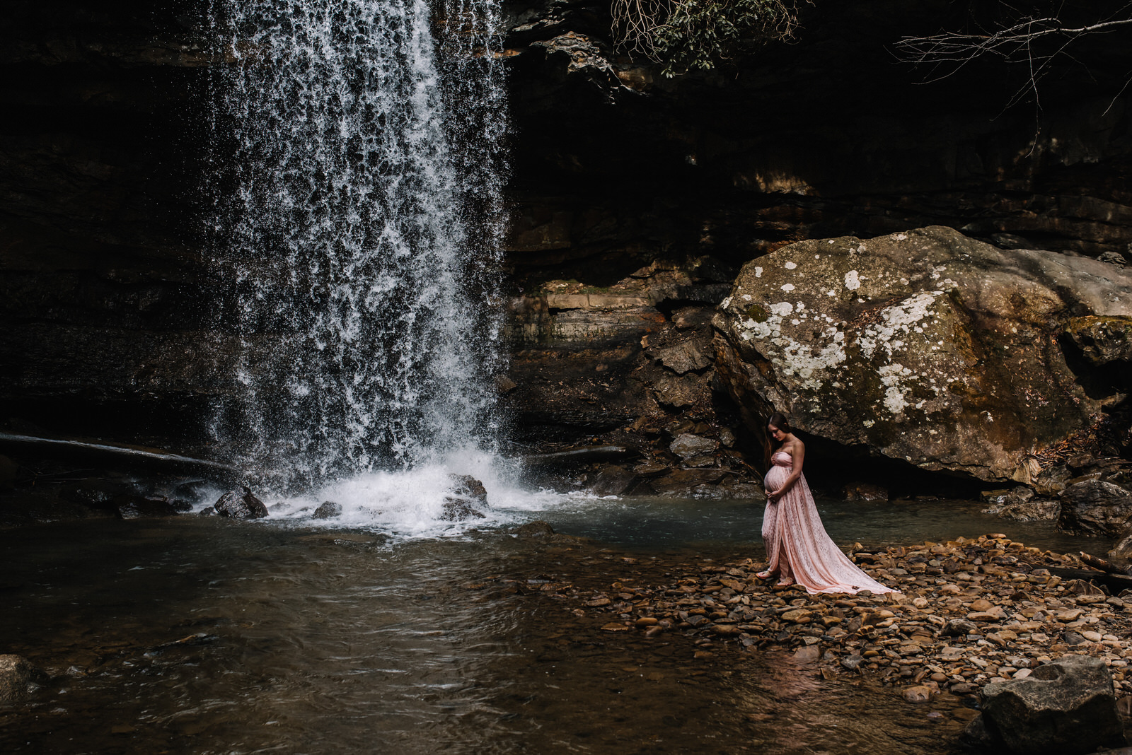 pregnant mom at ohiopyle waterfall for her maternity session