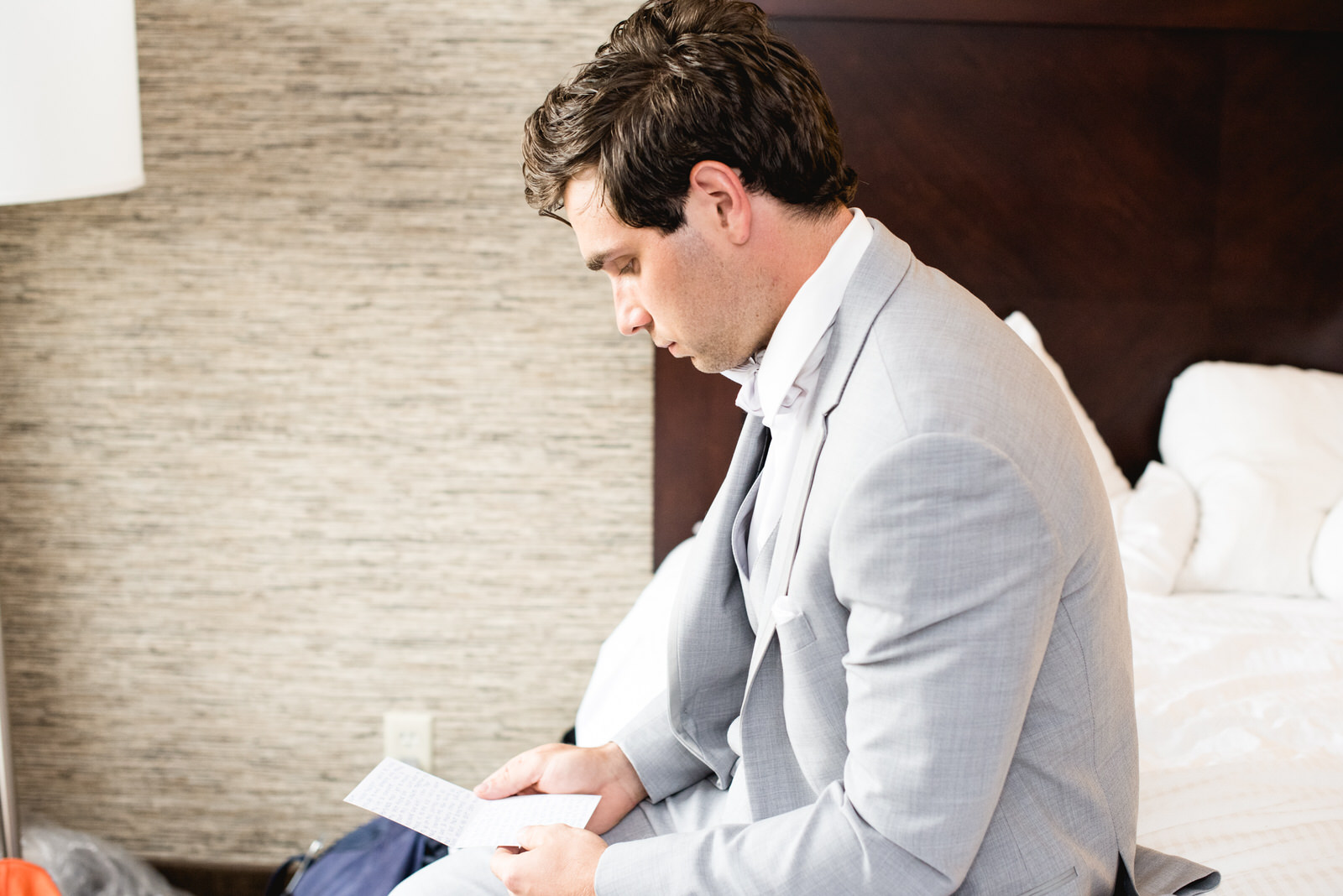 Groom reading note in hotel