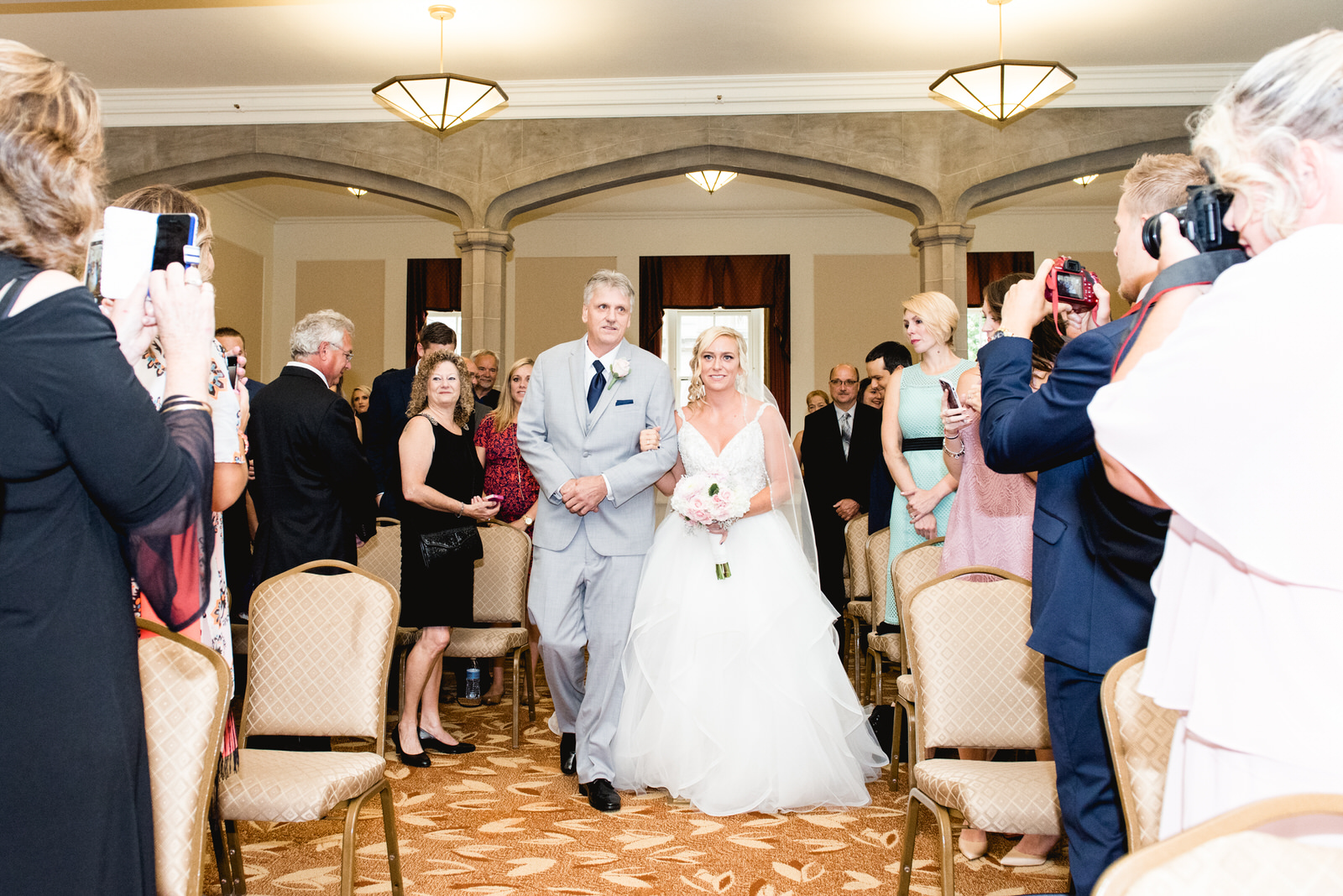 Dad walking bride down isle