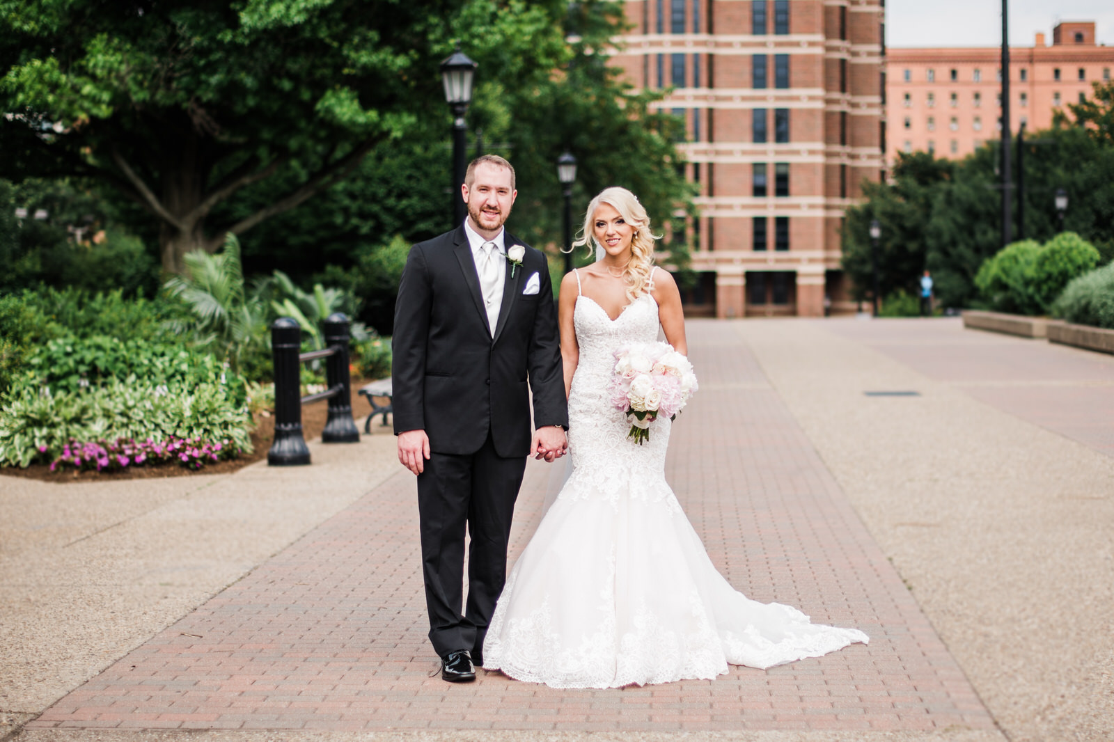 The bride and groom stopped for a posed shot at Duquesne University on the day of their wedding.