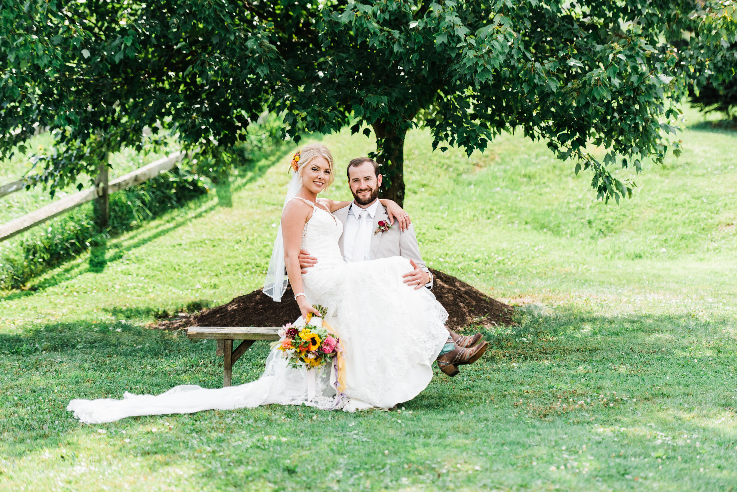 bride sits with groom at Armstrong Farms Wedding