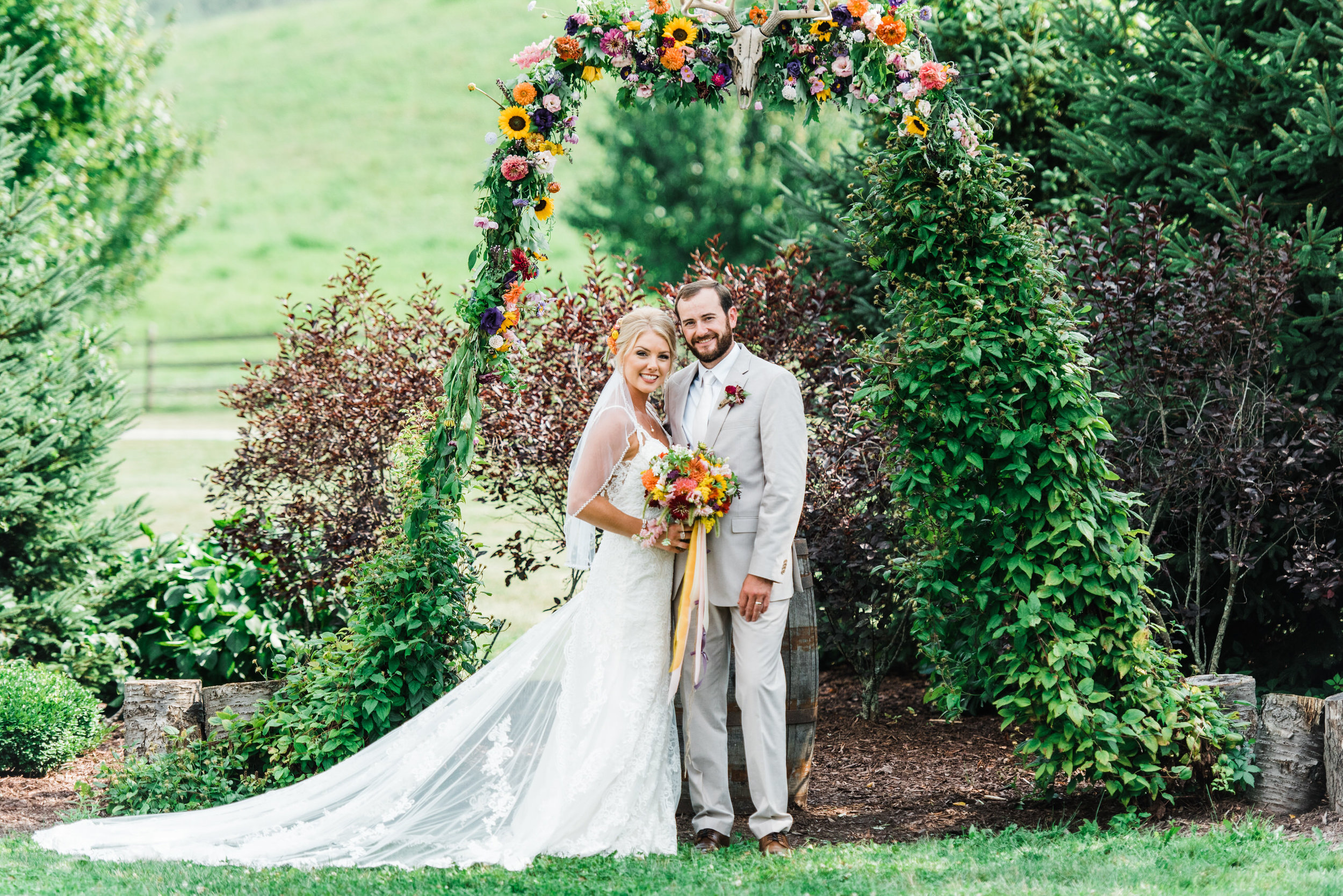 bride and groom at Armstrong Farms Wedding Venue arch