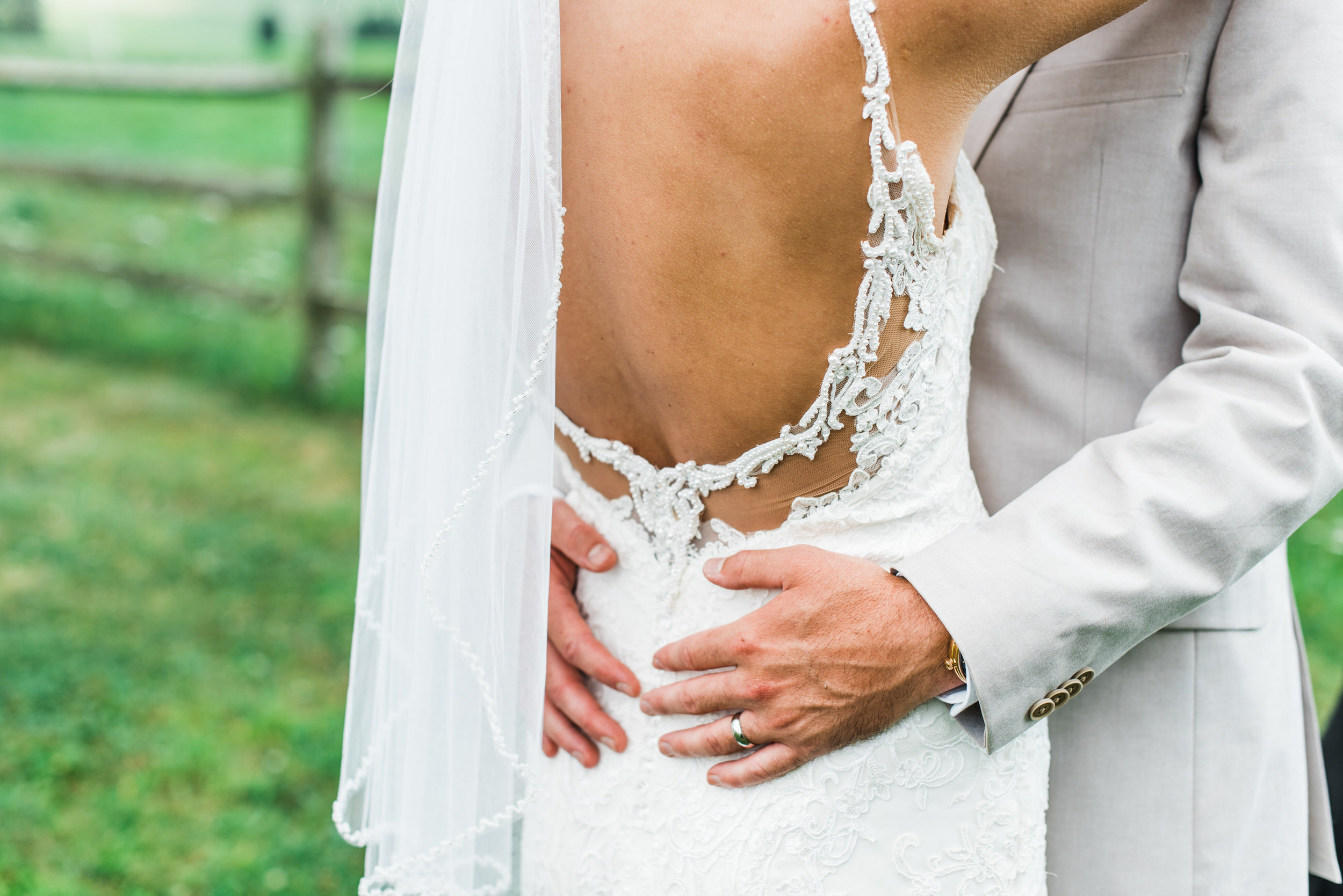 groom holds bride at armstrong farms