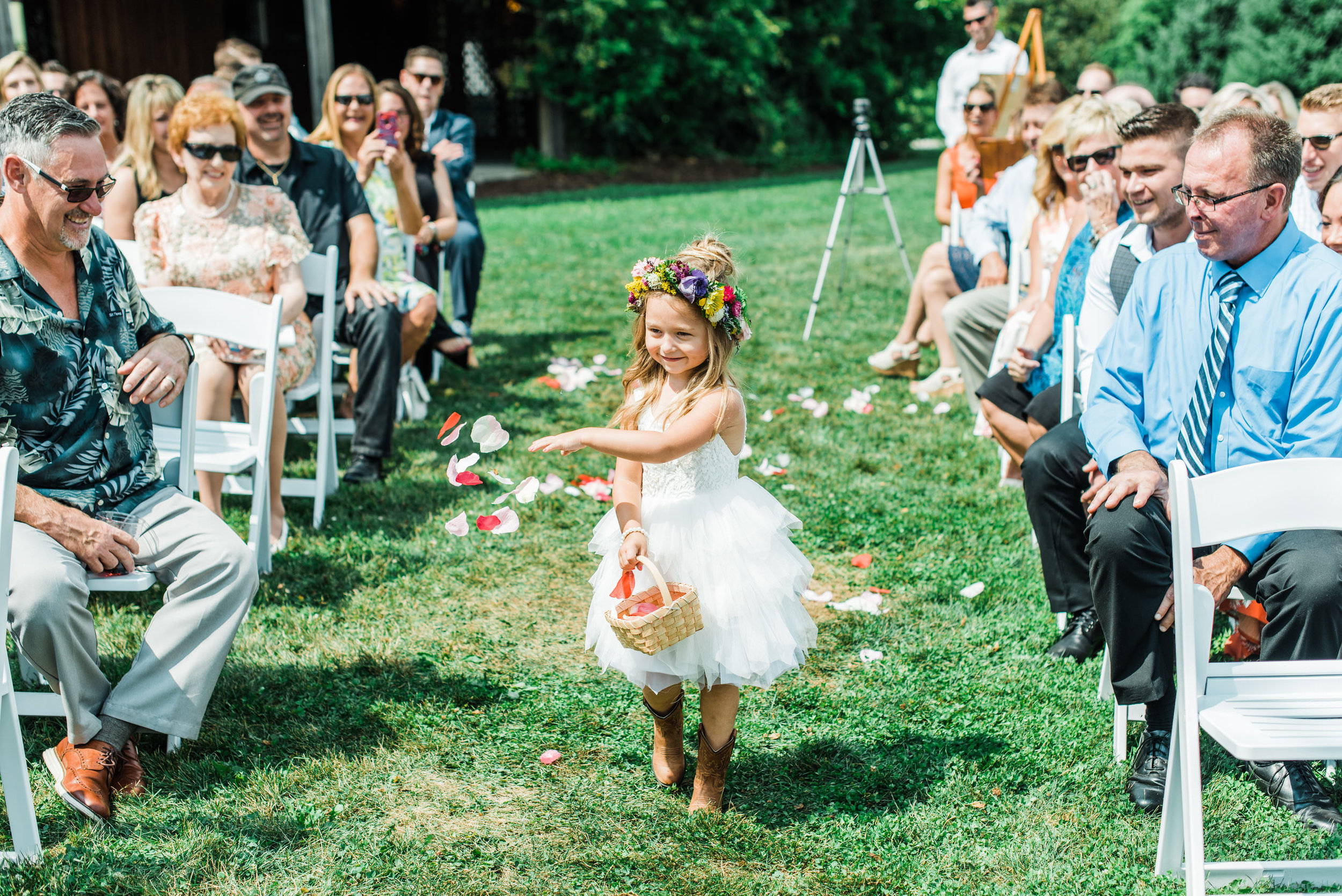flower girl comes down aisle at Armstrong Farms Wedding Venue