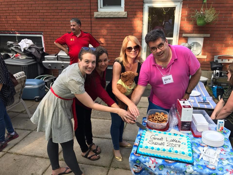 Cutting the cake at the annual Great Lakes Suzuki BBQ