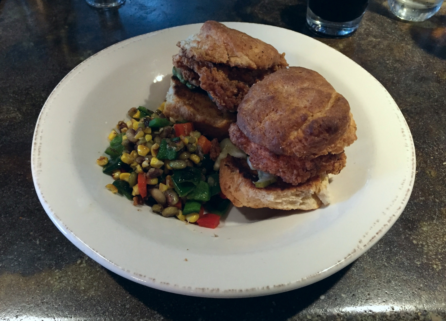 Chicken biscuit sandwich with a side of succotash