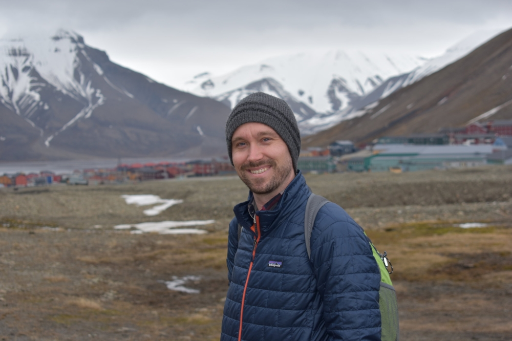 Albert with the frontier town of Longyearbyen behind him.