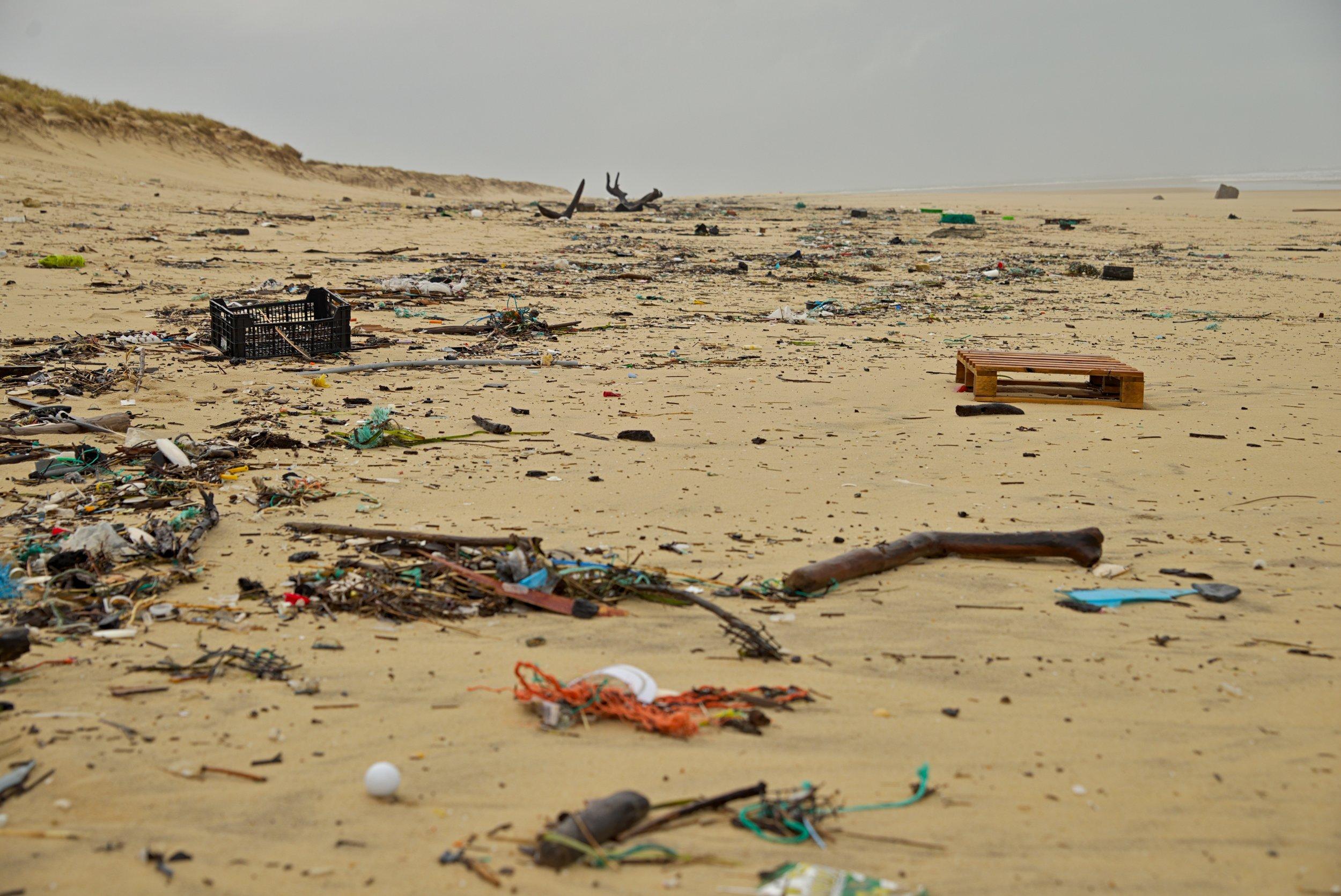 plastic littering a beach