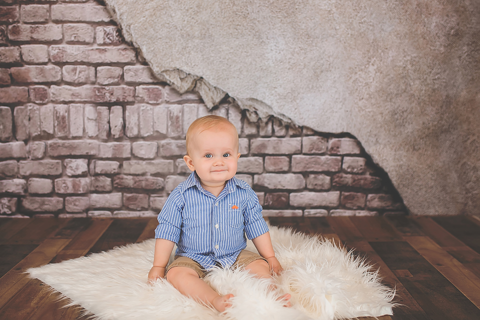 Baby Portrait with Brick Wall and Wood Floor