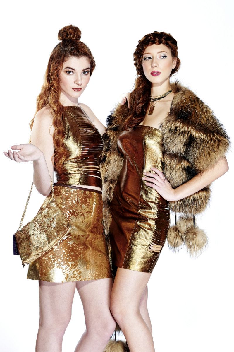 BRONZE LAMBSKIN SLASHED HALTER $495 GOLD ACID WASHED COWHIDE MINI SKIRT $695 MATCHING POSSIBLE BAG WITH WOVEN LEATHER CHAIN STRAPS $475 BRONZE LAMBSKIN STRAPLESS MINI DRESS WITH SLASHED SIDES $975 CANADIAN FINN RACCOON STOLE WITH POM POMS $1,800