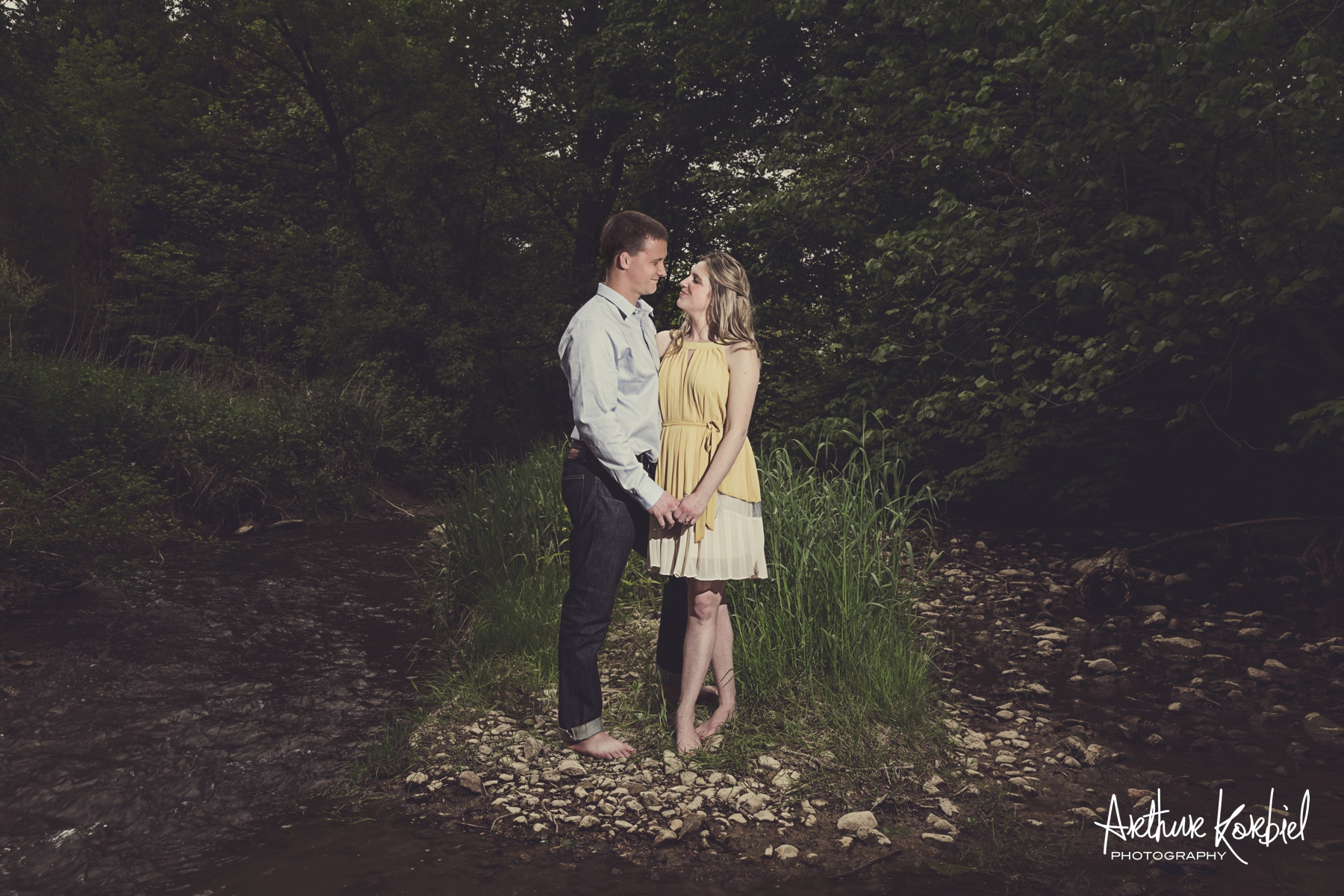 An example of formal clothing with a hint of casual from an engagement session.