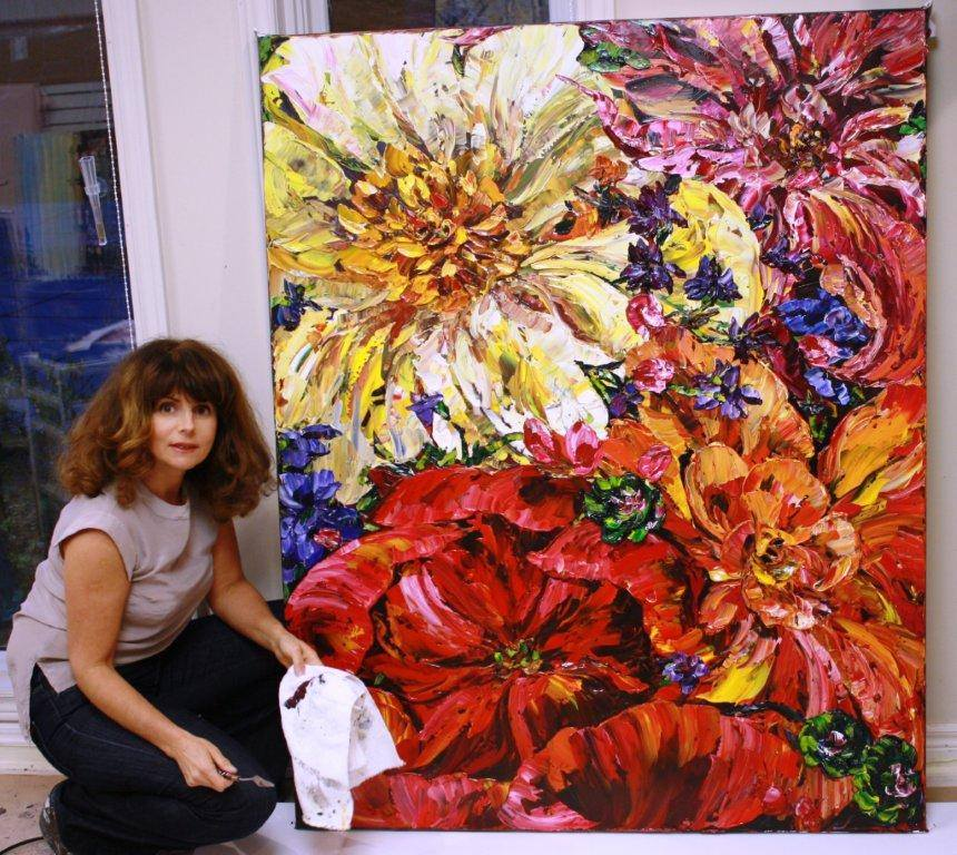 Maya Eventov finishing one of her beautiful palette knife floral paintings