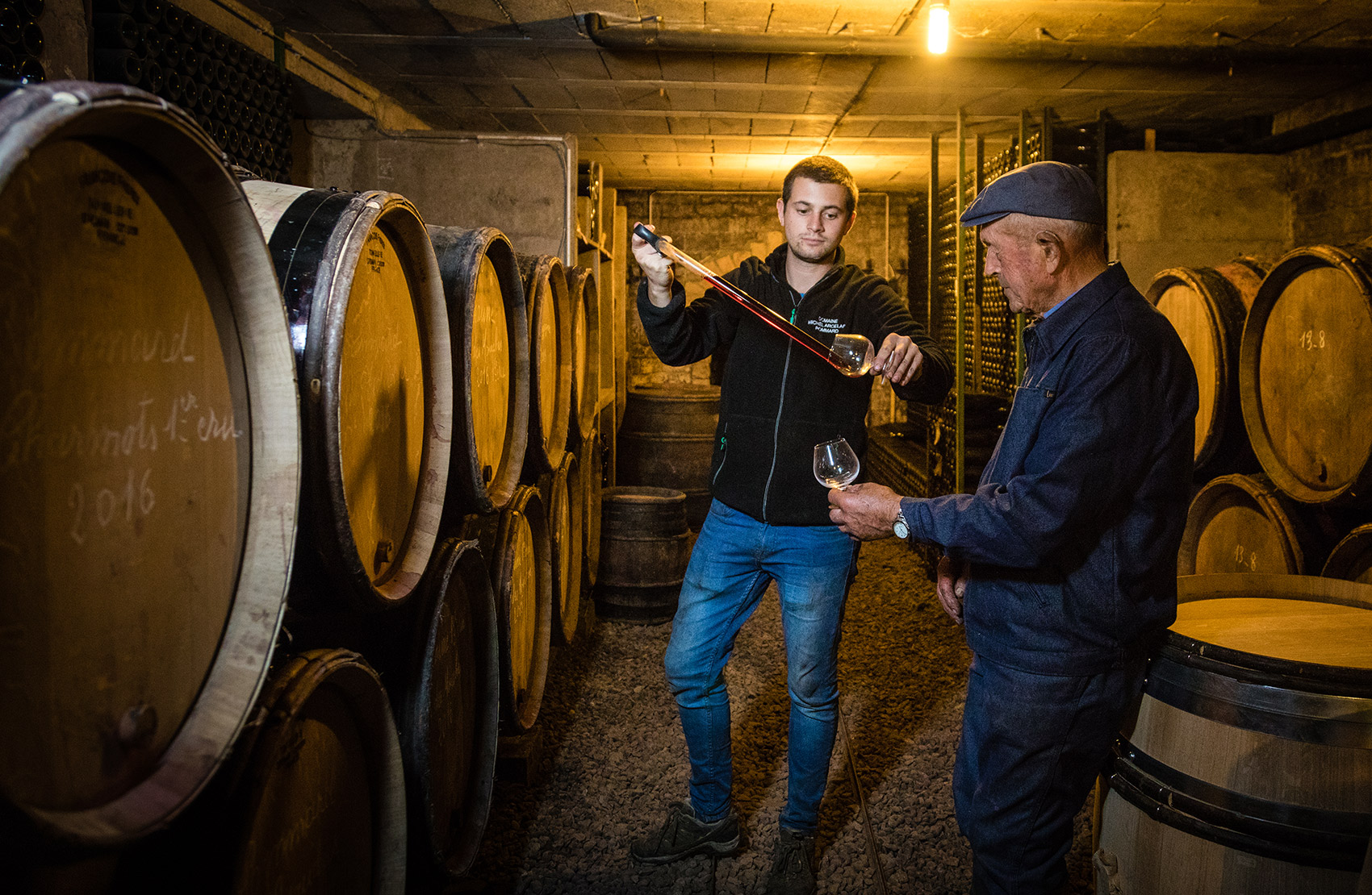 Marcel Arcelain in his beautiful cellar with his nephew Pierre.