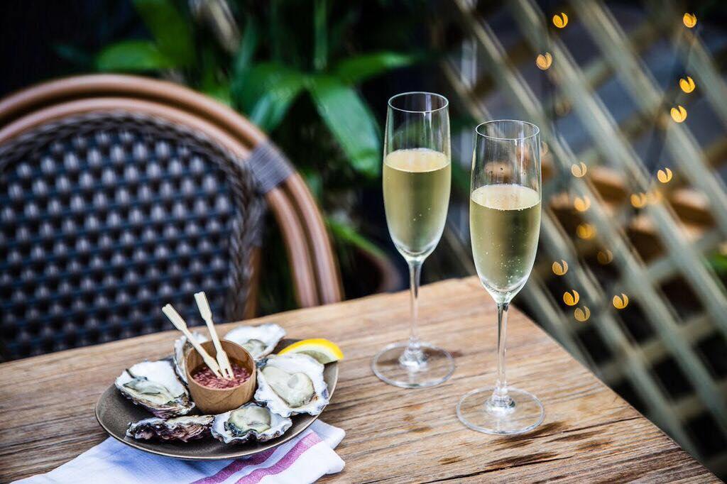 Champagne & oysters in Black Bottle's Darlinghurst courtyard