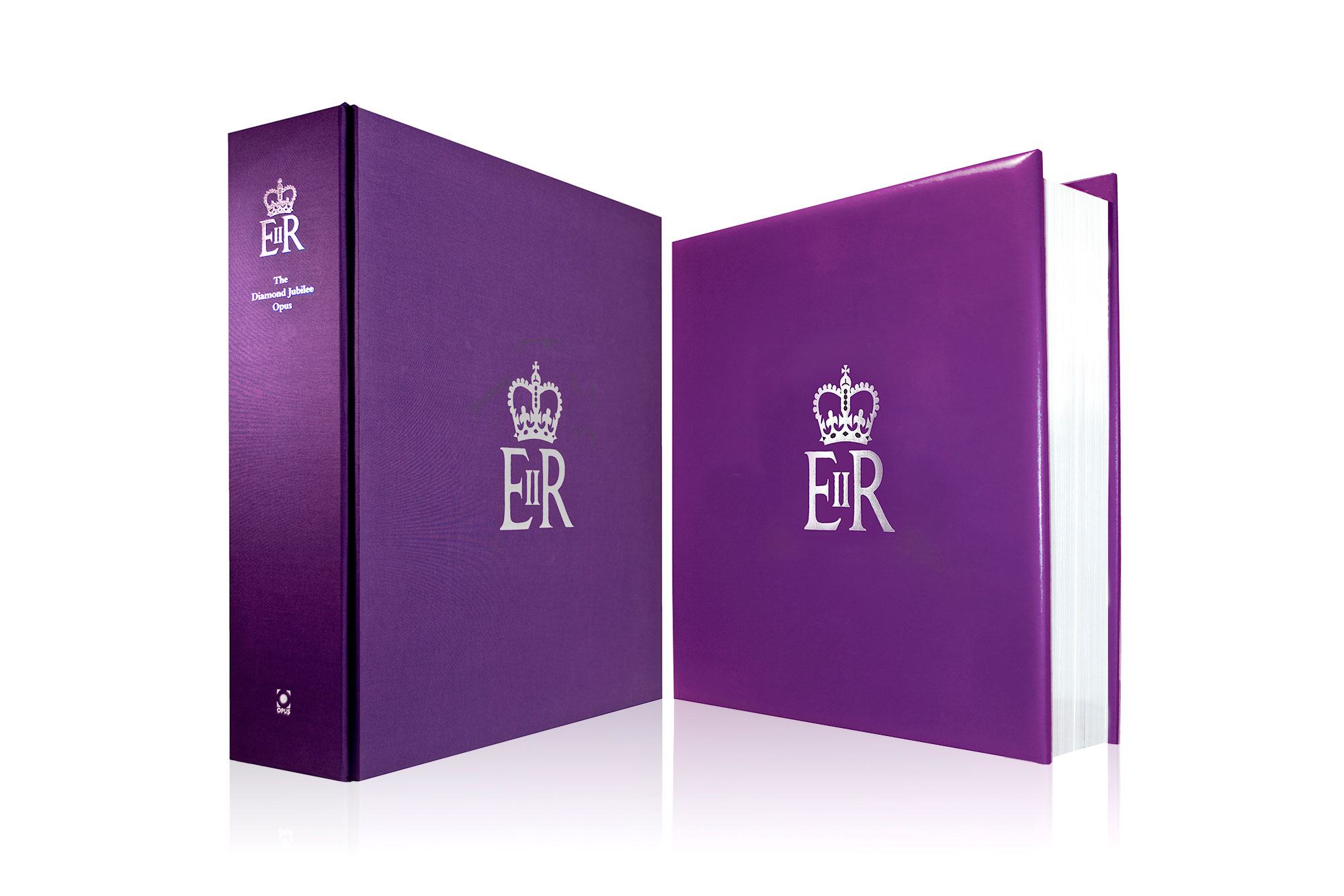 The book on the right and its protective case on the left, with the Royal Cypher foil stamped on the spine and the front. Design by Martin Sully.