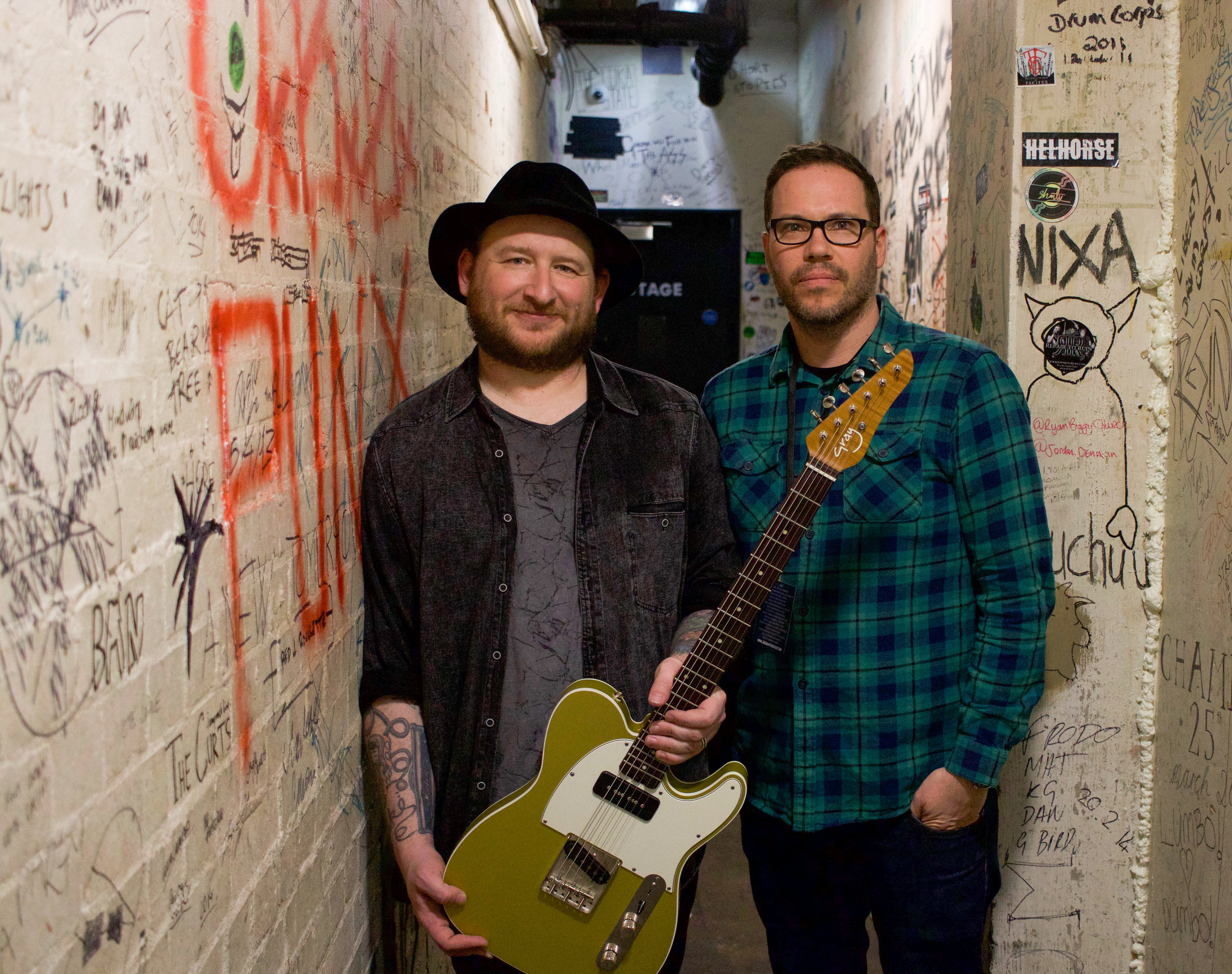 Josh Smith pictured backstage with Tom Gray at The Borderline in London, March 2019 - he is holding his Admiral model in Aztec Gold.