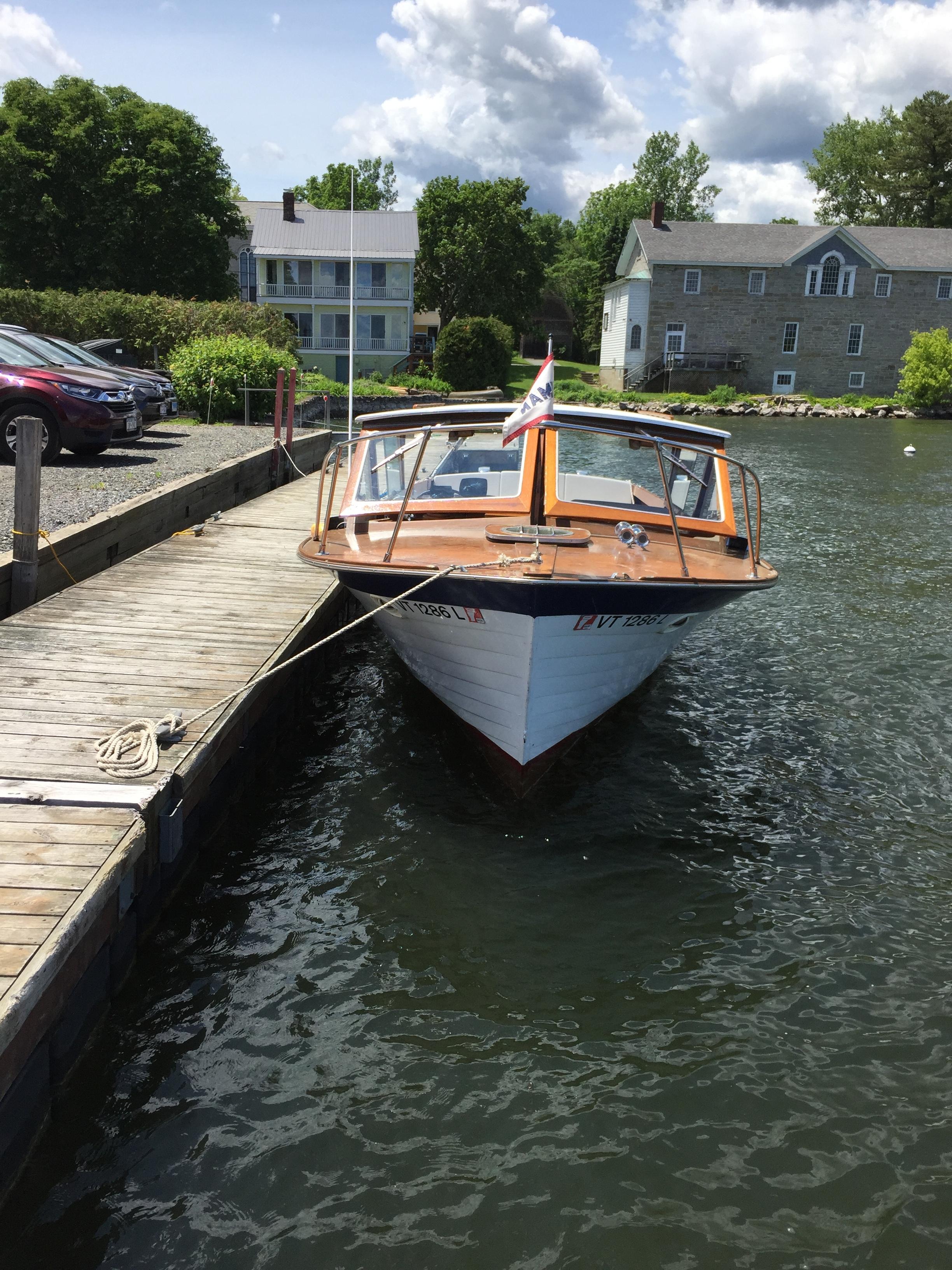 """Steve and Betsy Pond's boat, the Bessiana, a 1967 26"""" hardtop Lyman sleeper"""